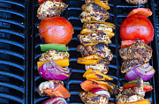 Hot Peppers Posters - Chicken And Pepper Kebabs Slowly Cooking On The Barbecue Poster by Fizzy Image