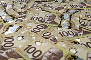 Banknote Photos - 100 Canadian dollar banknotes. by Fernando Barozza