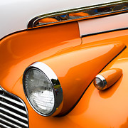 Headlamp Framed Prints - 1940 Orange and White Chevrolet Sedan Framed Print by Carol Leigh