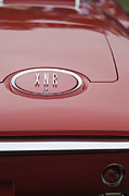 Roadster Photo Framed Prints - 1960 Plymouth XNR Ghia Roadster  Emblem Framed Print by Jill Reger