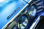 Landmarks Photo Posters - 1967 Chevrolet Chevelle Malibu Head Light Emblem Poster by Jill Reger