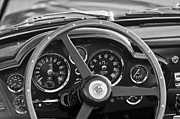 1967 Photos - 1967 Aston Martin DB6 Volante Steering Wheel Emblem by Jill Reger