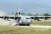 Dust Framed Prints - A C-130 Hercules Of The Italian Air Framed Print by Remo Guidi
