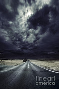 An Asphalt Road With Stormy Sky Above Print by Evgeny Kuklev