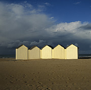Sandy Beaches Framed Prints - Beach huts under a stormy sky in Normandy. France. Europe Framed Print by Bernard Jaubert