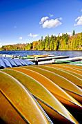 Canoes On Autumn Lake Print by Elena Elisseeva