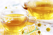 Teacup Photos - Chamomile tea by Elena Elisseeva