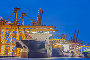 Town Pier Photos - Container Cargo freight ship with working crane by Anek Suwannaphoom