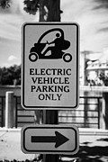 Electric Car Framed Prints - Electric Vehicle Parking Only Spaces Bays In Downtown Celebration Florida Usa Framed Print by Joe Fox