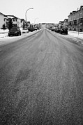 Winter Roads Posters - gritted salted cleared road in a residential housing suburbian development Saskatoon Saskatchewan Ca Poster by Joe Fox