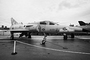 Naval Aircraft Prints - Israel Aircraft Industries Kfir on disply on the flight deck at the Intrepid Sea Air Space Museum Print by Joe Fox