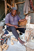 Folk Arts Posters - Kenya. December 10th. A man carving figures in wood. Poster by Michal Bednarek