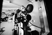 Projector Prints - lenses on old film projector in old cinema projection room Biggar Saskatchewan Canada Print by Joe Fox
