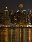 Moonscape Framed Prints - Moonrise Over Manhattan Framed Print by Susan Candelario