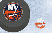 Puck Prints - New York Islanders Print by Joe Hamilton