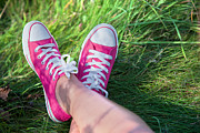 Retro Art - Pink sneakers on girl legs on grass by Michal Bednarek
