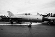 Manhatten Prints - Polish air force Mig 21 PFM on display on the flight deck at the Intrepid Sea Air Space Museum Print by Joe Fox