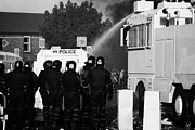 Unrest Framed Prints - PSNI riot officers behind armoured land rover and water cannon on crumlin road at ardoyne shops belf Framed Print by Joe Fox