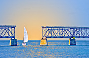 Bahia Honda Photos - Sailing Through the Flagler Bridge by Patrick M Lynch
