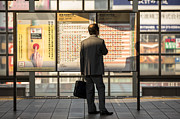 Checking Posters - Salaryman checking the train timetable Poster by Ruben Vicente