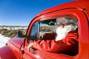Christmas Holiday Scenery Photos - Santa Driving A Vintage Red Ford by Michael DeYoung