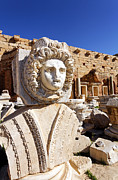 Medusa Photo Prints - Sculpted Medusa head at the Forum of Severus at Leptis Magna in Libya Print by Robert Preston