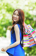 Shopping Bags Prints - Smiling girl with shopping bags Print by Anek Suwannaphoom