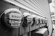 Sask Prints - snow covered electricity meters in Saskatoon Saskatchewan Canada Print by Joe Fox