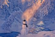 Snowy Evening Prints - Snowman Standing Next To A Stream Print by Kevin Smith
