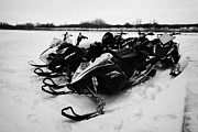 snowmobiles parked in Kamsack Saskatchewan Canada Print by Joe Fox