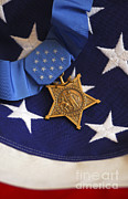 Medal Of Honor Prints - The Medal Of Honor Rests On A Flag Print by Stocktrek Images