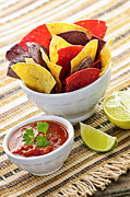Snacks Prints - Tortilla chips and salsa Print by Elena Elisseeva