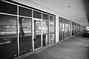 Commercial Real Estate Prints - Vacant Empty Strip Mall In Kissimmee Florida Usa Print by Joe Fox