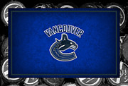 Puck Framed Prints - Vancouver Canucks Framed Print by Joe Hamilton