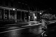 Pavement Prints - Walking In The Rain   Print by Bob Orsillo