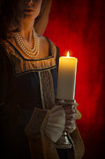 Candle Lit Prints - Woman In A Blue Medieval Dress Holding A Candle Print by Lee Avison