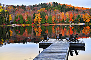 Reflections Posters - Wooden dock on autumn lake Poster by Elena Elisseeva