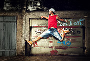 Figure Pose Posters - Young man jumping on grunge wall Poster by Photocreo Michal Bednarek