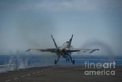Military Strike Posters - An Fa-18c Hornet Launches Poster by Stocktrek Images