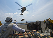 Pallet Framed Prints - An Mh-60s Sea Hawk Helicopter Lowers Framed Print by Stocktrek Images