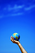 Conceptual Art - Earth globe in hands. Conceptual image by Michal Bednarek