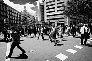 Crosswalk Framed Prints - People Walking Across Busy Pedestrian Crossing Placa De Catalunya Barcelona Catalonia Spain Framed Print by Joe Fox