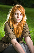 Looking Sideways Prints - Romantic portrait of a young redhead girl sitting in the park. Print by Alstair Thane