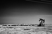 Sask Prints - snow covered prairie agricultural farming land with pumpjacks oilfield winter Forget Saskatchewan Ca Print by Joe Fox