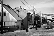 Finnmark Framed Prints - Snow Covered Street Of Traditional Wooden Houses In Kirkenes Finnmark Norway Europe Framed Print by Joe Fox
