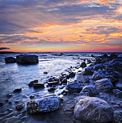 Pebbles Photos - Sunset over water by Elena Elisseeva