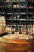 Chardonnay Prints - Wine glasses and barrels Print by Elena Elisseeva