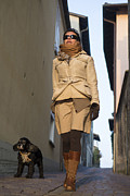 Dog Walking Posters - Woman walking with her dog Poster by Mats Silvan