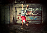 Figure Pose Posters - Young man jumping on grunge wall Poster by Michal Bednarek