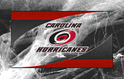 Puck Framed Prints - Carolina Hurricanes Framed Print by Joe Hamilton